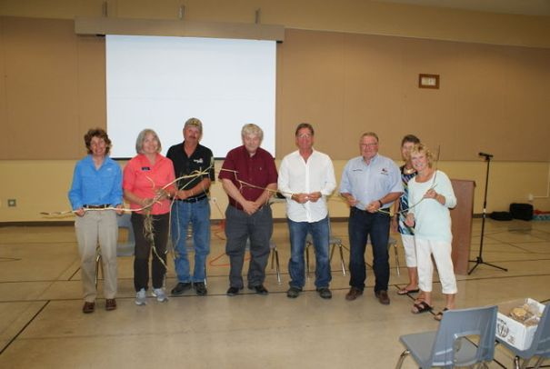 Phrag fighters. From left to right: Dr. Janice Gilbert, Nature Conservancy Canada and Ontario Phragmites Working Group; Kate Monk, Ausable Bayfield Conservation Authority; Al Williamson, Williamson Farms; Don McCabe, President, Ontario Federation of Agriculture; Ken Vegh, Municipal Drainage & Inspection Supervisor, Town of Kingsville; Mayor Bill Weber, Lambton Shores; Nette Pachlarz, Director, Lambton Shores Phragmites Community Group; Nancy Vidler, Chair, LSPCG. One stem of Phragmites can grow to more than three metres in height and send out several new runners from its stem. (photo – Bill MacDonald)