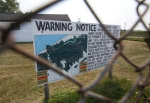 A sign warns visitors to the former army camp at the Chippewas of Kettle and Stony Point First Nation of unexploded ordnance in parts of the 2,400 acre site in Ipperwash. (Free Press file photo)