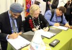 Minister of National Defence Harjit Sajjan (left), Minister of Indigenous and Northern Affairs Dr. Carolyn Bennett and Kettle and Stony Point Chief Tom Bressette sign the final Ipperwash settlement
