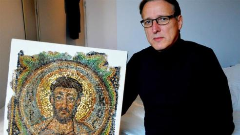 Dutch art detective Arthur Brand found the mosaic, which was in the possession of a British couple [Jan Hennop/AFP]