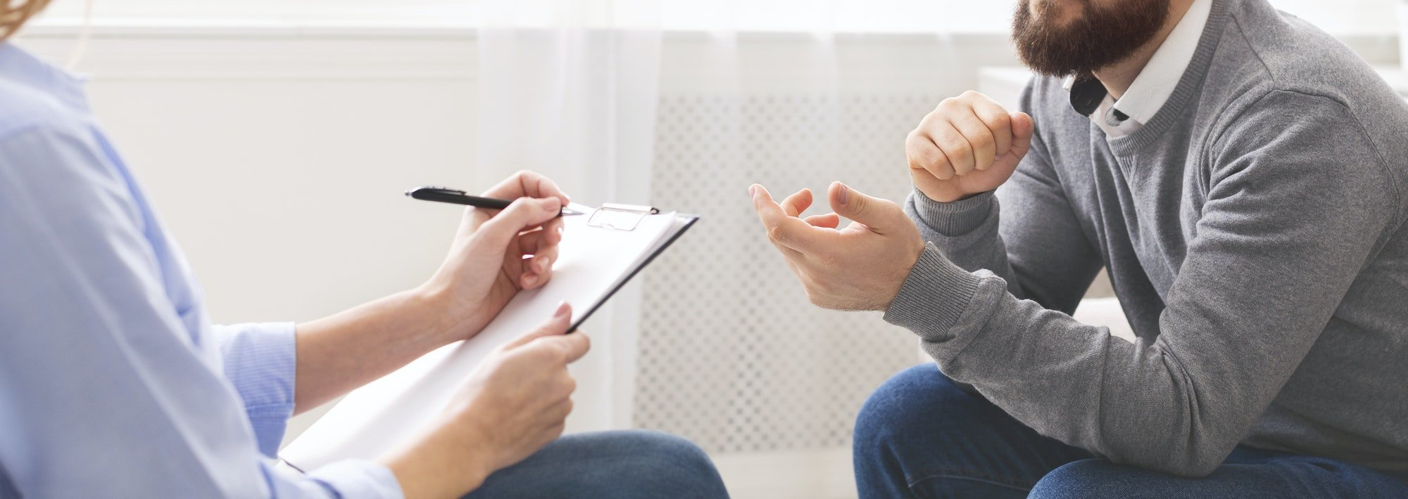 Man with mental problem talking with psychologist during session