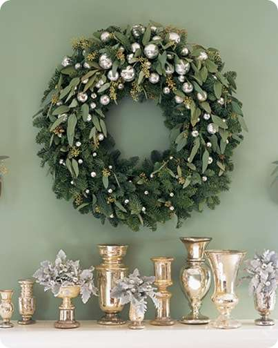 Create this glittering decoration by trimming a noble fir wreath with silvery ornaments and sprigs of seeded eucalyptus.