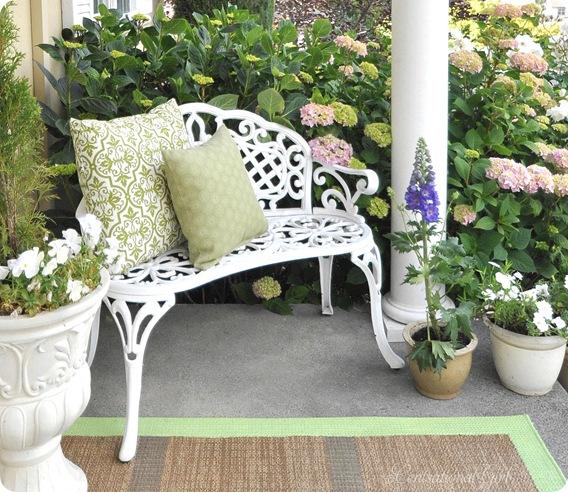 white bench green pillows hydrageas