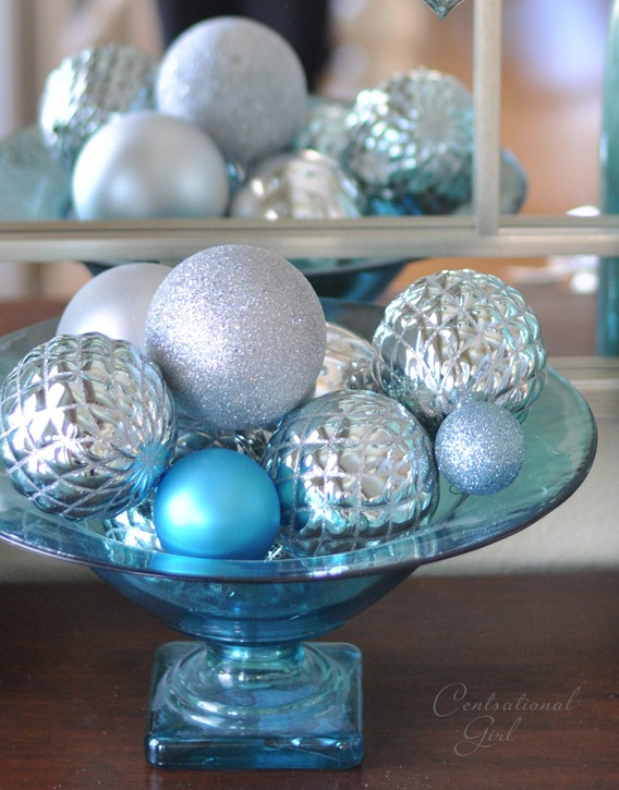 blue glass compote with ornaments