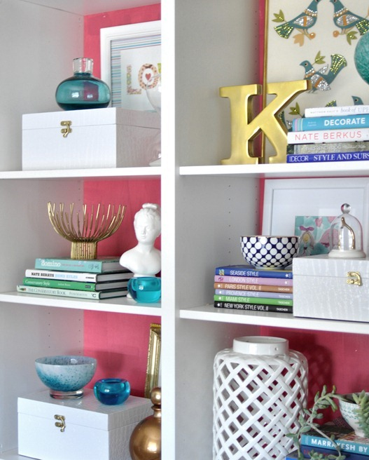 pink and white bookcases