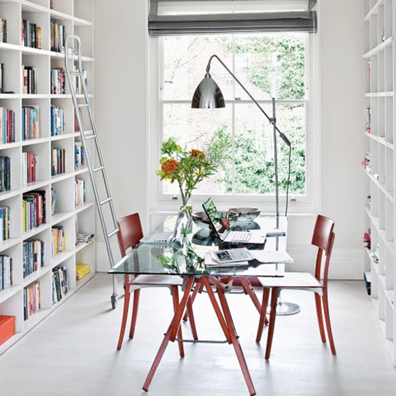 white bookshelves in dining room