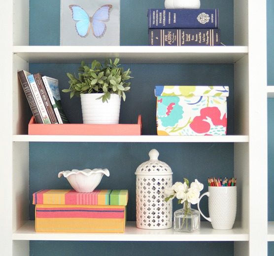 fabric covered boxes on shelf