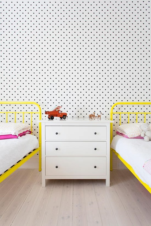 yellow beds and polka dot wall