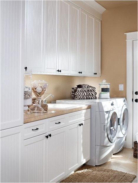 laundry room with white cabinets