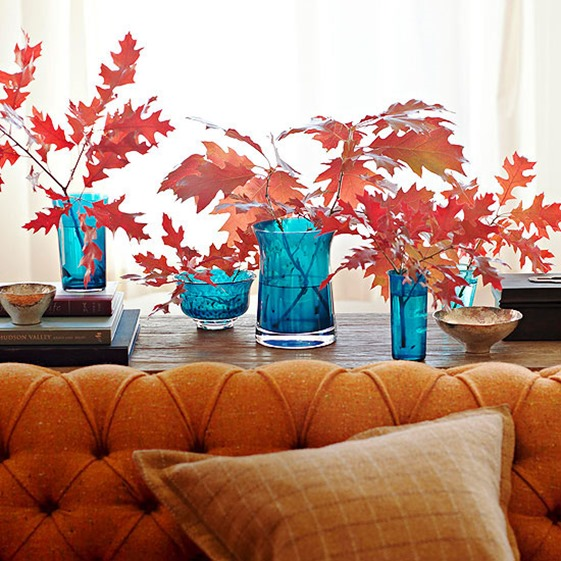 orange leaves blue vases bhg