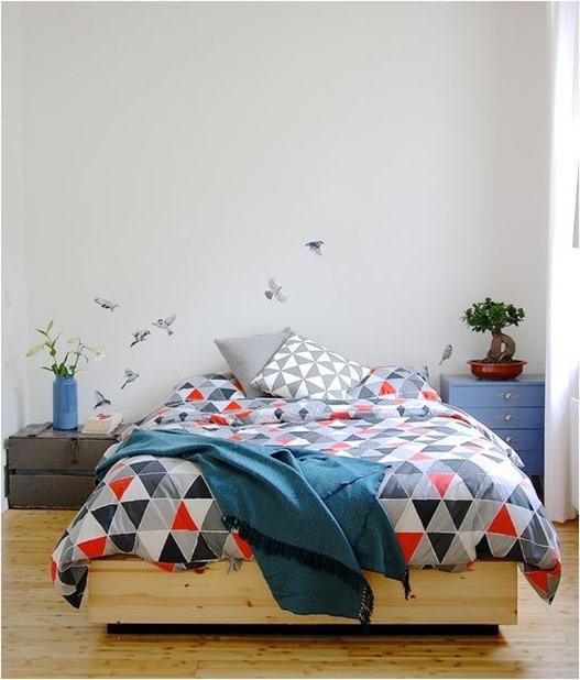 mismatched nightstands in bedroom