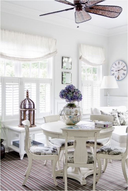 white sunroom dining space
