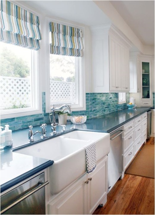 blue backsplash striped roman shades in kitchen