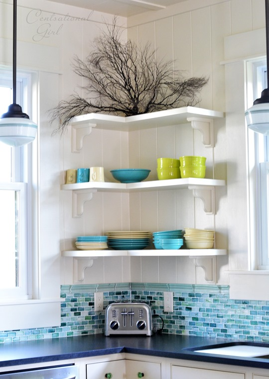 open shelves glass backsplash