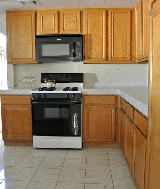 Two Tone Kitchen Cabinets White And Oak: Disappearing Microwaves