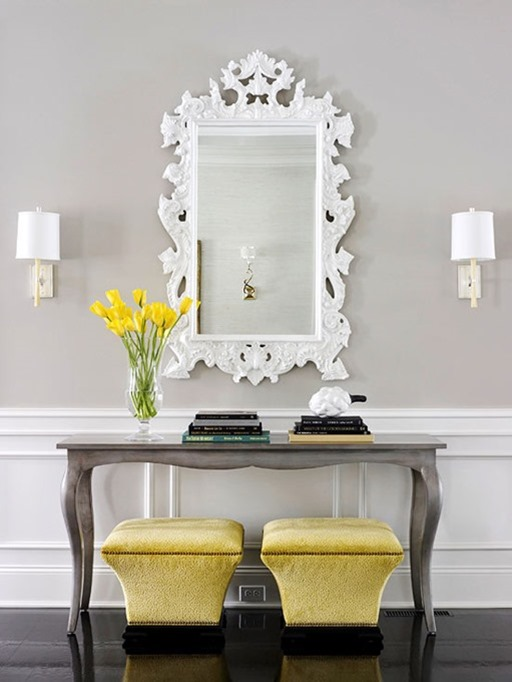 console with books and mirror