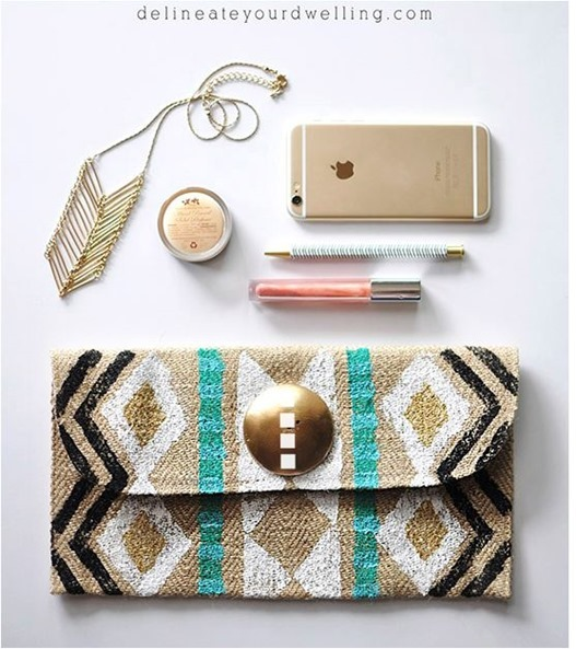 stamped tribal clutch