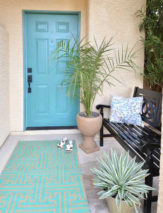 painted front door black bench on porch