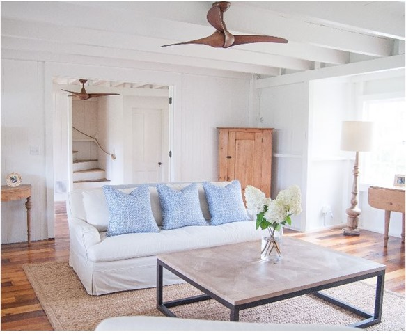 coastal living room with wood ceiling fan
