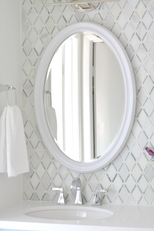 Awesome white oval vanity mirror