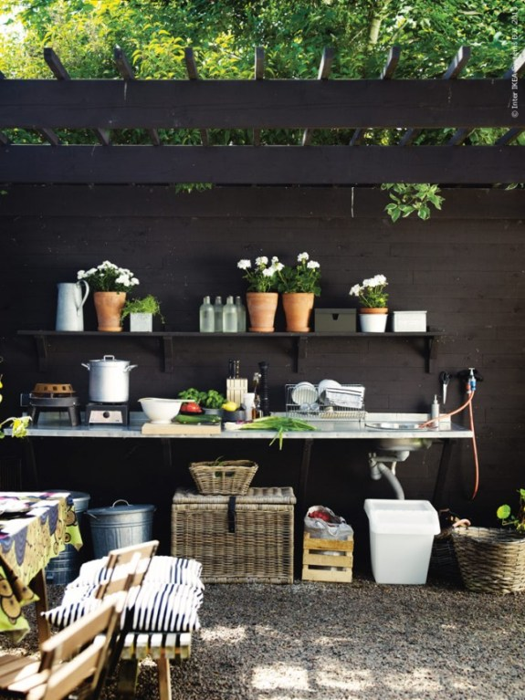black fence arbor shelving