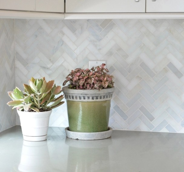 marble herringbone kitchen backsplash