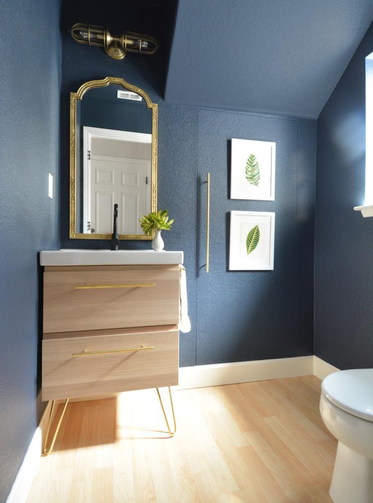 navy walls pale wood vanity