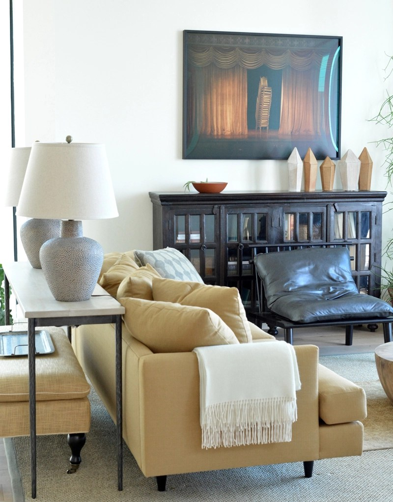 butter yellow sofa in family room