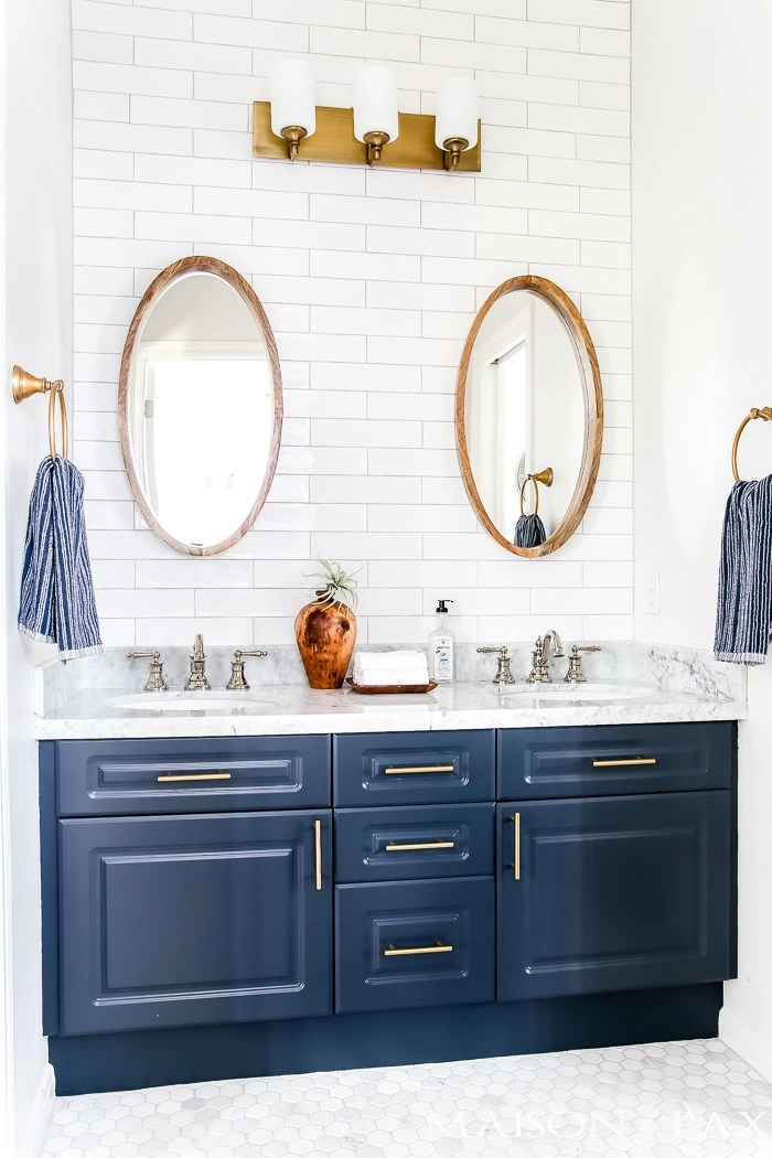 Again, Shiny Nickel Faucets And Matte Brass Hardware And Sconces.