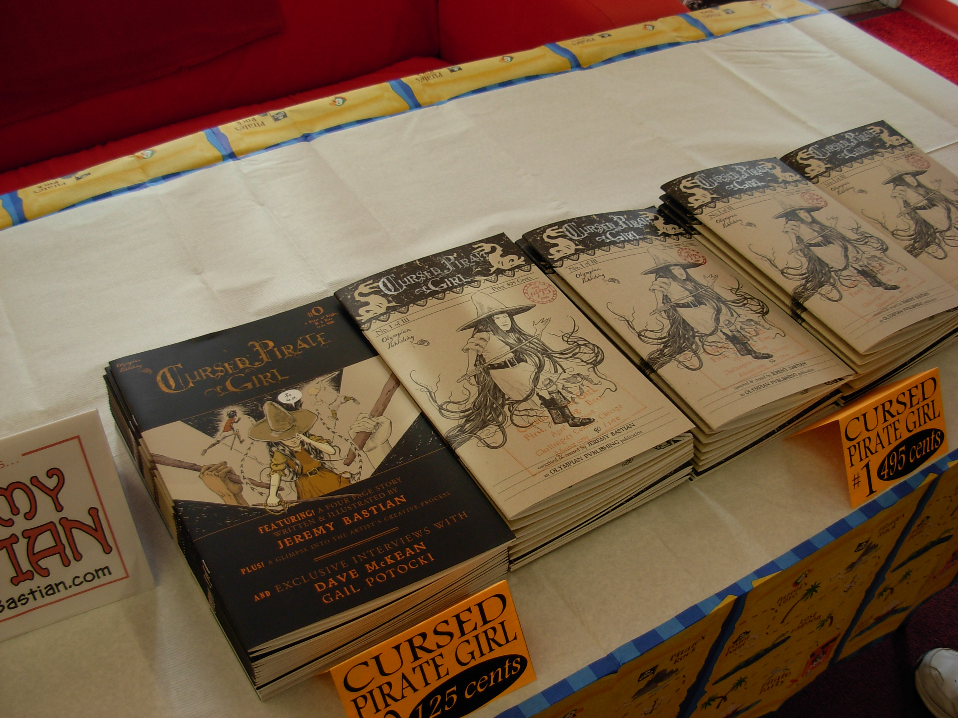 The rare promotional book Cursed Pirate Girl #0, and advance copies of Cursed Pirate Girl #1