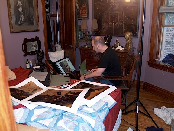 """Jim Kay with multiple color variations of """"Mélies (Untitled)"""" checks them against the monitor."""
