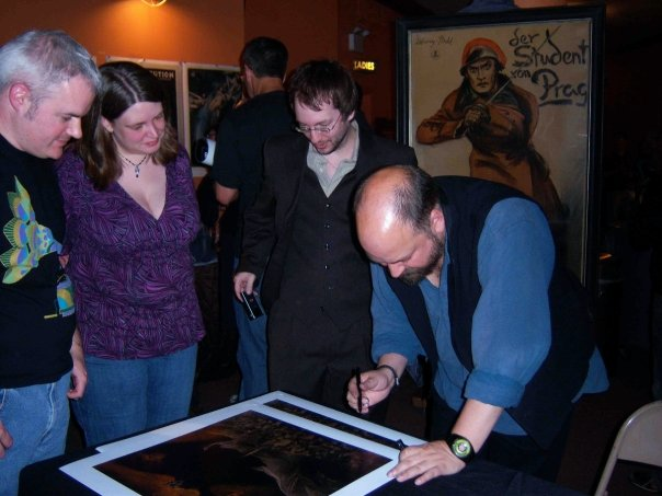 Signing the first Faust print