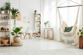 Green Pillow On A Hammock And Plant On Pouf In Bright Living in 26+ Amazing Living Room Hammock