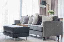 Modern Grey Sofa With Pillows And Black Table In Living Room for ucwords]