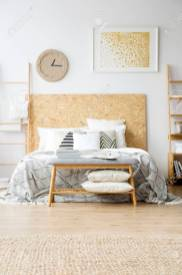Pillows On Wooden Bench In Boho Bedroom With Gold Painting And in ucwords]