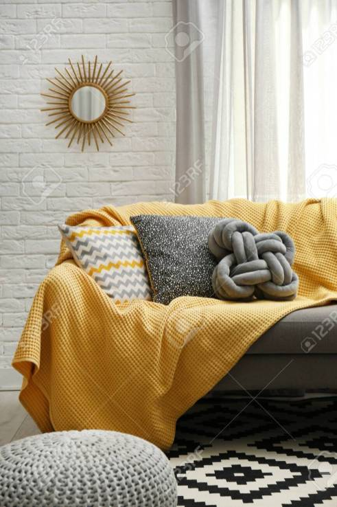 Soft Pillows And Yellow Plaid On Sofa In Living Room regarding ucwords]