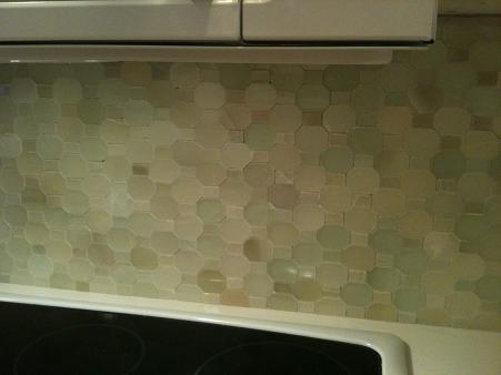 polished green onyx mosaic backsplash