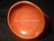 peça ceramica vermelha