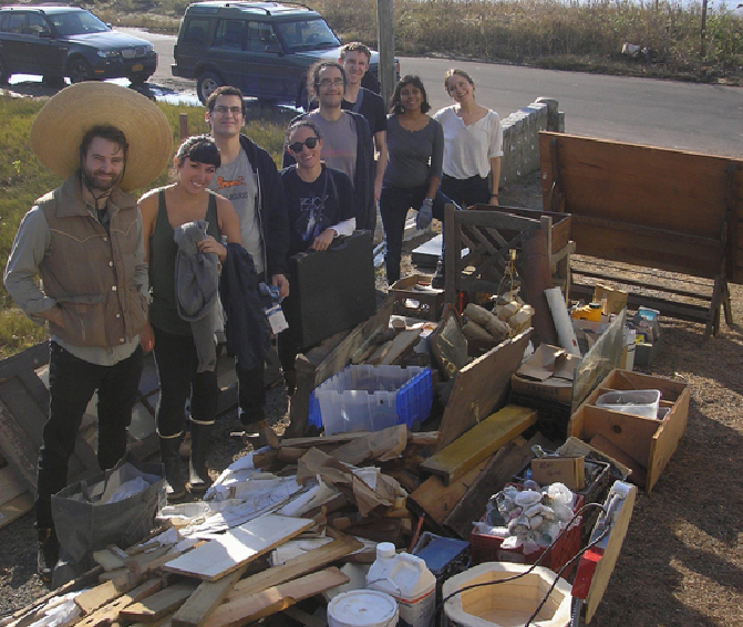 Volunteers help with a studio clean-up.