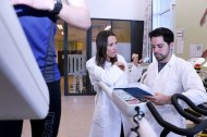 Lady and man in white talking on exercice lab