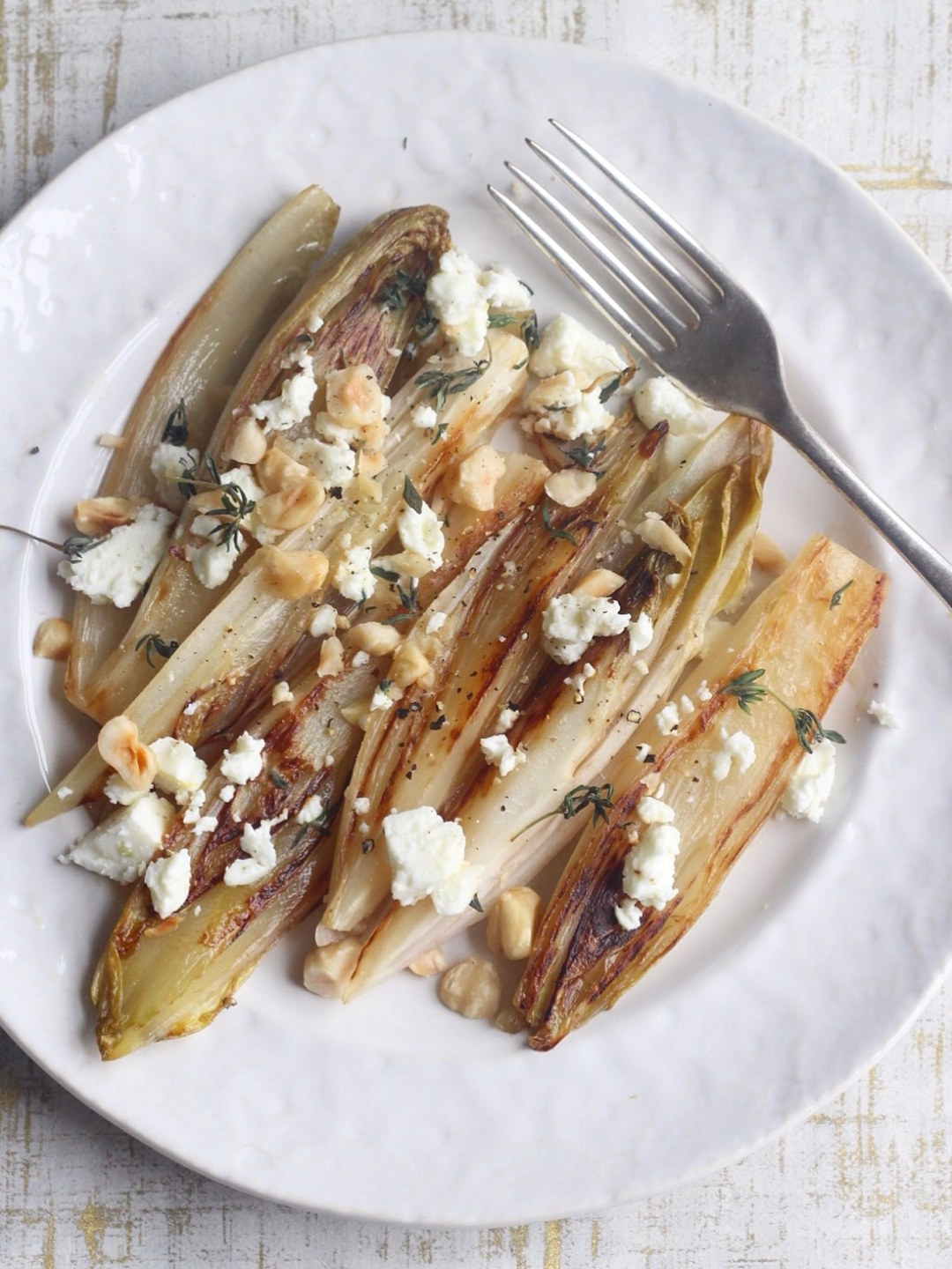 Pan-fried chicory with feta and hazelnuts