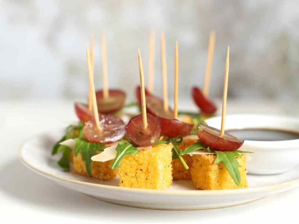 Parmesan Polenta Bites with Rocket & Grape, a Christmas canapé on Natural Kitchen Adventures, gluten free