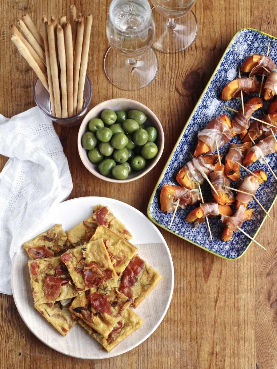 Parma Ham Aperitivo; Farinata with Softened Onions & Parma Ham and Red Kuri Squash Bites Wrapped with Parma Ham