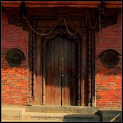 Wooden door in Nepal, do you see the eyes?