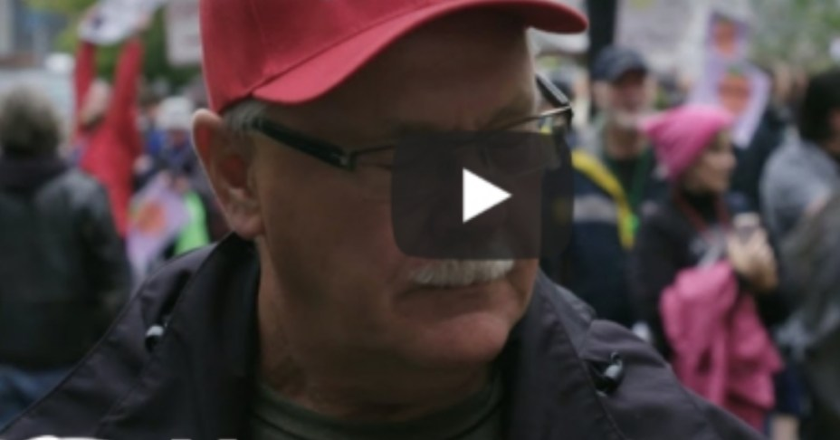 Watch Anti Trump protesters spits on man putting on MAGA Cap