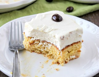 Irish Cream Tres Leches - A traditional tres leches cakes soaked with three milks (cream, condensed milk, evaporated milk) but now with an added kick from Bailey's Irish Cream liqueur. This cake is perfect for your St. Patrick's Day celebrations!