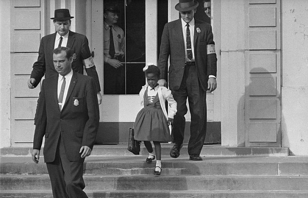 This little girl, Ruby Bridges, had to be escorted by federal deputy marshals for her own safety