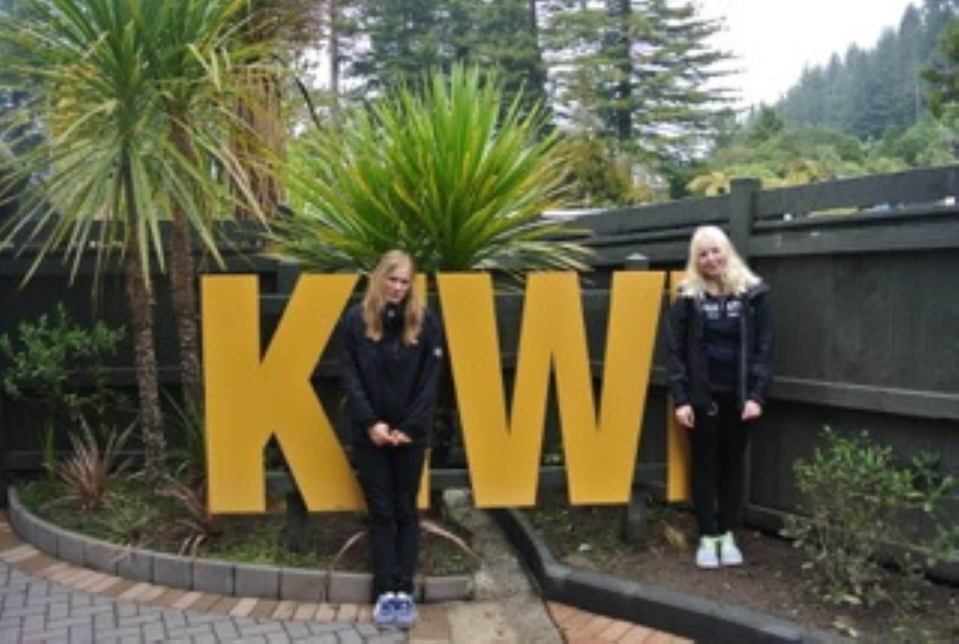 australia Exchange students with a sign Kiwi