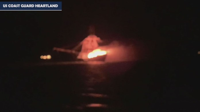 Coast Guard rescues four from ship fire