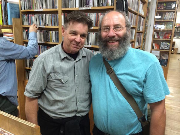 Don Campau and Al Margolis pose in front of a CD library in 2014. (Courtesy of Don Campau)